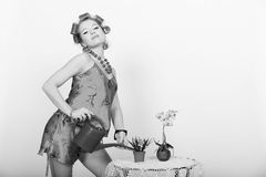 Pin up girl watering the flowers Stock Photography