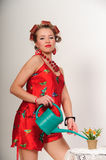 Pin up girl watering the flowers Royalty Free Stock Photo