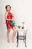 Pin up girl watering the flowers Royalty Free Stock Images