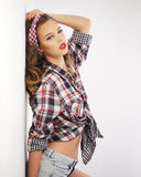 Pin-up girl wearing a checked headband Royalty Free Stock Images