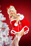 Pin-up girl wearing santa claus clothes Stock Images