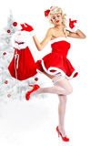 Pin-up  girl wearing santa claus clothes Stock Images