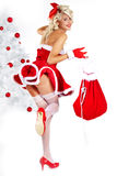 Pin-up  girl wearing santa claus clothes Royalty Free Stock Image
