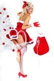 Pin-up  girl wearing santa claus clothes Royalty Free Stock Image