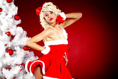 Pin-up  girl wearing santa claus clothes Stock Photo