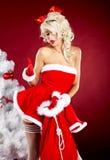 Pin-up  girl wearing santa claus clothes Stock Image
