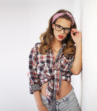 Pin-up girl wearing thick rimmed glasses Stock Image