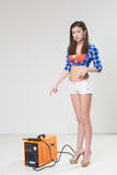 Pin-up girl with the welder. Royalty Free Stock Photography