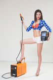 Pin-up girl with the welder. Stock Image