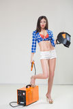 Pin-up girl with the welder. Stock Photos
