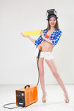 Pin-up girl with the welder. Stock Photo