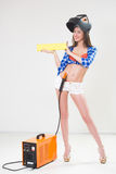 Pin-up girl with the welder. Royalty Free Stock Photo