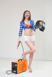 Pin-up girl with the welder. Royalty Free Stock Image