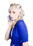 Pin up girl whispering with handkerchief Royalty Free Stock Images