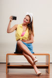 Pin up girl woman taking photo with camera. Royalty Free Stock Image