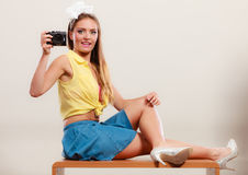 Pin up girl woman taking photo with camera. Stock Photo
