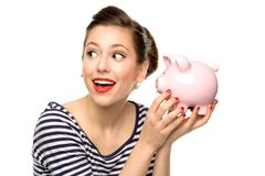 Pin-up-Girlholding piggybank Stockbild