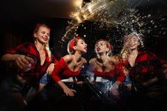 Pin up girls  having fun in nightclub stock photo