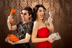 Pin-Up girls screaming at vintage phone. And big glasses Stock Photo