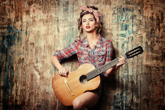 Pin-up with guitar Royalty Free Stock Image
