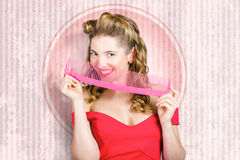 Pin up hairdresser woman with hair salon brush Royalty Free Stock Image