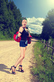 Pin up hitchhiking Stock Photography