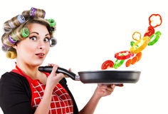 Pin up housewife cooking fresh vegetables Royalty Free Stock Photos