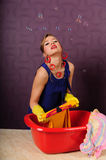 Pin up housewife wash clothes Stock Image