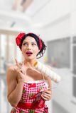 Pin up lady with paint roller having creative idea Royalty Free Stock Photography