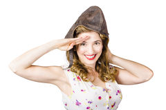 Pin up lady saluting in fighter pilot cap Royalty Free Stock Images