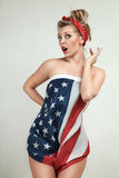 Pin-Up model. Sexy blond pin-up model wrapped in american flag Royalty Free Stock Photo