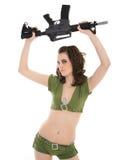 Pin-up model waving rifle Royalty Free Stock Image