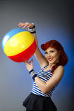 Pin up model in sailor costume isolated on blue background Stock Photo