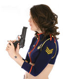 Woman in sailor outfit with pistol. Woman pin-up model dressed in skimpy sailor suit holding pistol pointing upwards on white background stock images