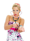 Pin-up portrait of woman checks the pulse. stock photography