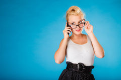 Pin up retro gril with glasses and phone. Royalty Free Stock Photos