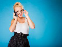 Pin up retro gril with glasses and phone. Royalty Free Stock Photo