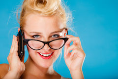 Pin up retro gril with glasses and phone. Stock Photography