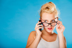 Pin up retro gril with glasses and phone. Stock Photo