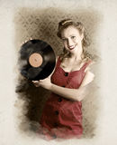 Pin-Up Rockabilly Woman Holding Vinyl Record LP. Smiling Vintage Pin-Up Girl Holding American Record In A Depiction Of 60s Rockabilly Life Style Stock Photo