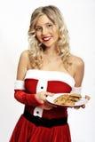 Pin up santa girl with cookies Stock Image