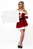 Pin up santa girl holds blank sign Royalty Free Stock Photo