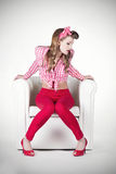 Pin-up sitting on Armchair. Cool concept Royalty Free Stock Photo
