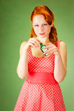 Pin-up style girl holding a bottle. Pin-up style girl holding a small bottle Stock Photo