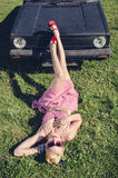 Pin-up style girl posing with car Royalty Free Stock Photos