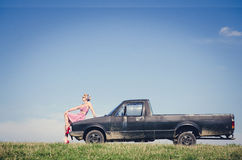 Pin-up style girl posing with car Stock Photography
