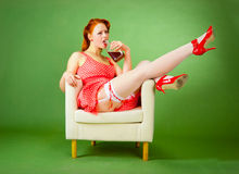 Pin-up style girl sitting on the chair Stock Photos
