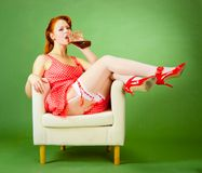 Pin-up style girl sitting on the chair Royalty Free Stock Photo