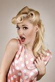 Pin-up style portrait of surprised blonde woman Royalty Free Stock Image