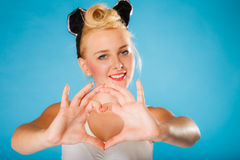 Pin up style, retro girl with heart sign. Stock Image